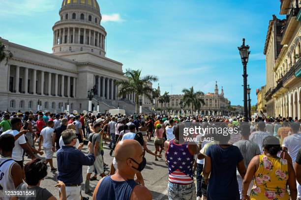 Cubans are seen outside Havana's Capitol during a demonstration against the government of Cuban President Miguel Diaz-Canel in Havana, on July 11,...
