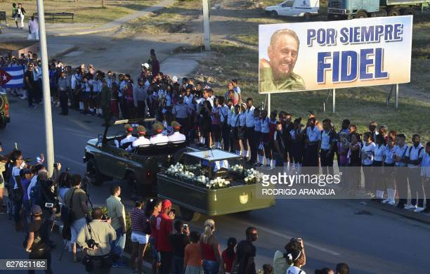 TOPSHOT Cubans attend the passage of the urn with the ashes of Cuban leader Fidel Castro from Revolution Square in Santiago Cuba on December 4 2016...