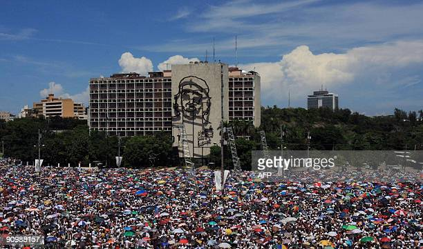 Cubans attend the Peace without Borders concert on September 20 2009 at Revolution Square in Havana Over half a million Cubans were expected to...