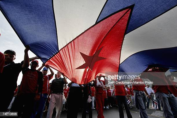 Cubans carry a giant Cuban flag during an AntiTerrorism march on January 24 2006 in Havana Cuba The governmentorganized march began with a speech by...