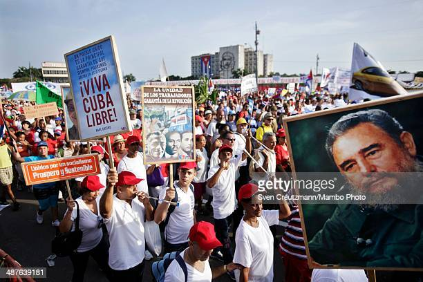 Cubans carry the image Cuba's Revolution leader Fidel Castro during the annual march of thousands of Cubans celebrating May Day at Revolution Square...