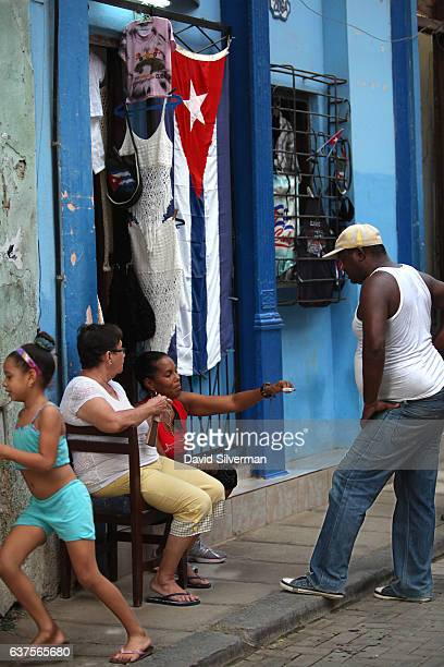 Cubans chat outside of their souvenir stall on December 18 2015 in ciudad vieja Habana the old city of Havana Cuba Tourism in Cuba is an industry...