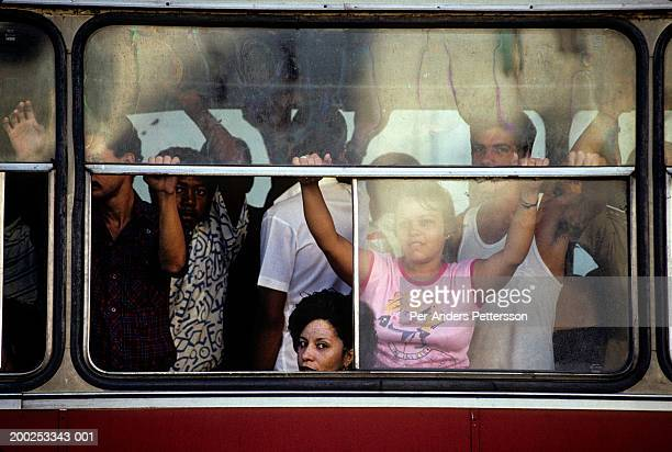 cubans commuters in a crowded bus in havana, cuba - per-anders pettersson stock pictures, royalty-free photos & images