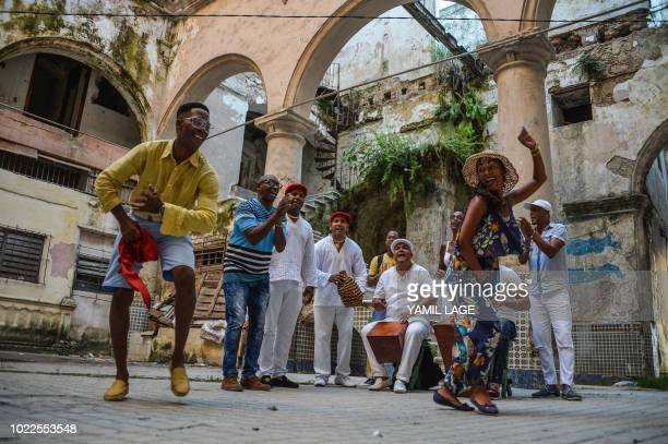 Cubans dance Rumba in a street of Havana on August 22 2018 The Rumba a mix of African and Spanish culture considered by UNESCO an Intangible Cultural...
