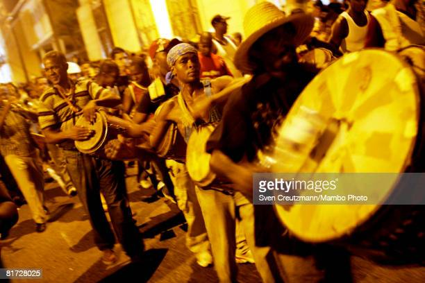 Cubans hit their drums as conga groups march through the streets during the Camaguey carnival June 24 2008 in Camaguey Cuba The first day celebration...