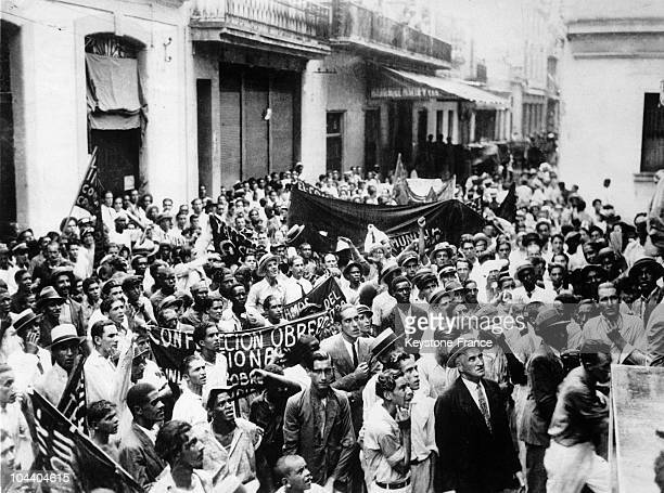 Cubans marching in the streets of Havana after Fulgencio BATISTA took power on September 4 to protest against Yankee imperialism in other words...