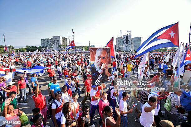 Cubans participate in a march celebrating workers day at the Plaza de la Revolucion on May 1 2016 in Havana Cuba Cuba celebrates workers day shortly...