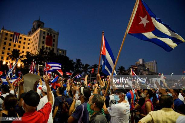 Cubans participate in an act of revolutionary reaffirmation to support the government of President Miguel Diaz-Canel in Havana, on July 17, 2021. -...