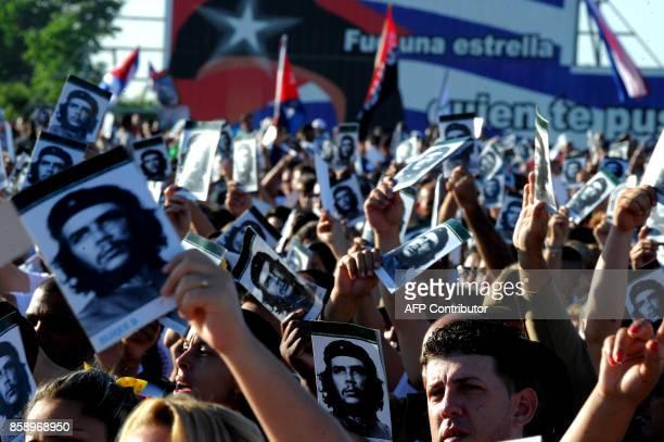 Cubans participate in the commemoration of the 50th anniversary of Ernesto Che Guevara's death at the Che Guevara Memorial in Santa Clara Cuba on...
