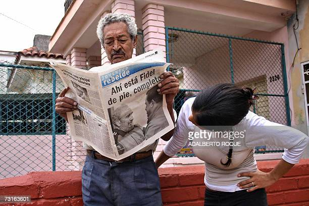 Cubans read a newspaper with images of President Fidel Castro meeting with his Venezuelan counterpart Hugo Chavez in Havana 31 January 2007 The...