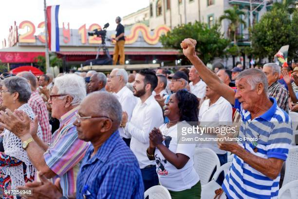 Cubans shout revolution slogans during a political act commemorating the 57th anniversary of a speech in which Fidel Castro declared the revolution...