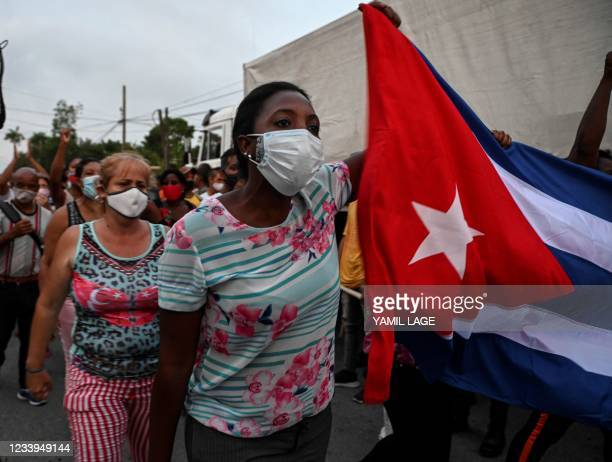Cubans take part in a demonstration in support of Cuban President Miguel Diaz-Canel's government in Arroyo Naranjo Municipality, Havana on July 12,...