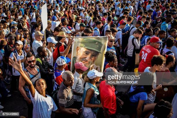 Cubans take part in the May Day rally the last to be overseen by President Raul Castro and the first without his late brother and revolutionary...