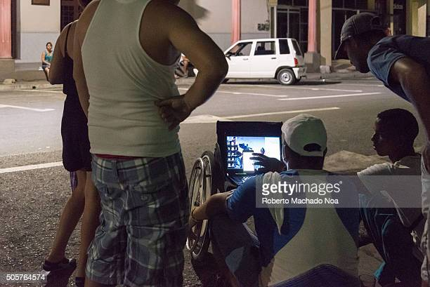 Cubans using Wifi connections in public areas during night These public networks with a cost of 2 dollars per hour are the first legal internet...