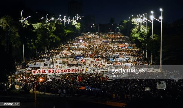 TOPSHOT Cubans wait early in the morning on May 1 2018 to march to Revolution Square in Havana during the May Day rally