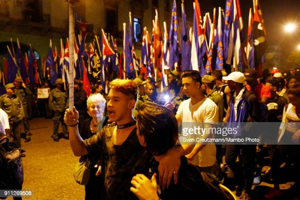 Cubans walk during a march as Cuba celebrates the 165 anniversary of the birth of its national hero Jose Marti on January 27 in Havana Cuba Raul...