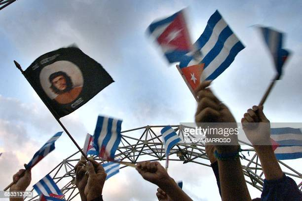 Cubans wave Cuban flags during a protest against what Havana sees as aggressive moves by Washington 18 November 2002 in Havana Official media called...