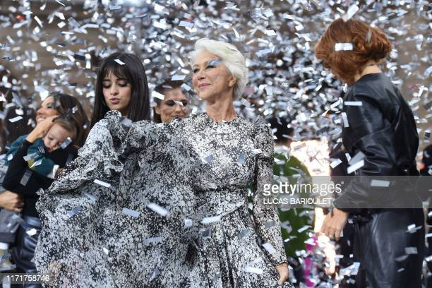 Cuban-US singer Camila Cabello, British actress Helen Mirren and British singer Geri Horner applaud while presenting creations for L'Oreal during the...