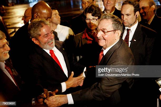 Cuba's acting President and brother of Fidel Castro Raul Castro shakes hands with Brazil's President Luiz Inacio Lula da Silva before leaving at the...