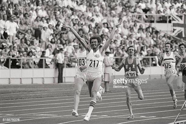 Cuba's Alberto Juantorena raises his arms in victory as he crosses the finish line to win the men's 800 meters race at the 1976 Summer Olympics in...