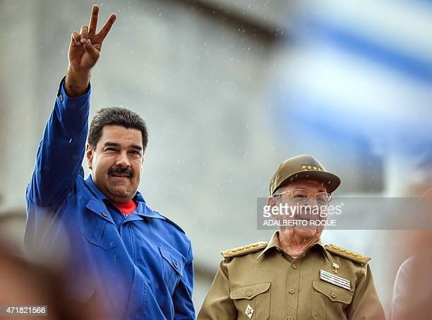Cuba's and Venezuela's Presidents Raul Castro and Nicolas Maduro respectively participate in the May Day celebrations on May 1 2015 in Havana AFP...