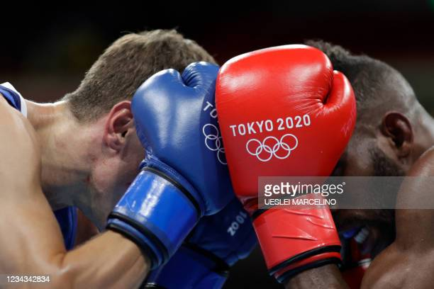 Cuba's Andy Cruz and Britain's Luke McCormack fight during their men's light preliminaries round of 16 boxing match during the Tokyo 2020 Olympic...