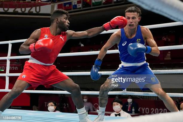 Cuba's Andy Cruz punches Australia's Harry Garside during their men's lightweight 63-kg boxing match at the 2020 Summer Olympics on August 6 in...