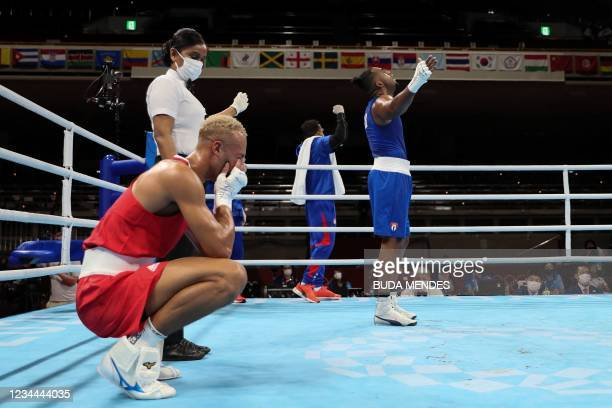 Cuba's Arlen Lopez celebrates after winning against Britain's Benjamin Whittaker after their men's light heavy boxing final bout during the Tokyo...