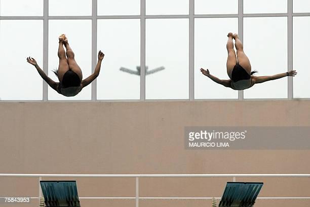Cuba's Daile Valdes and Yaima Mena perform during the Rio 2007 XV Pan American Games diving 3m synchro springboard final in Rio de Janeiro Brazil 28...