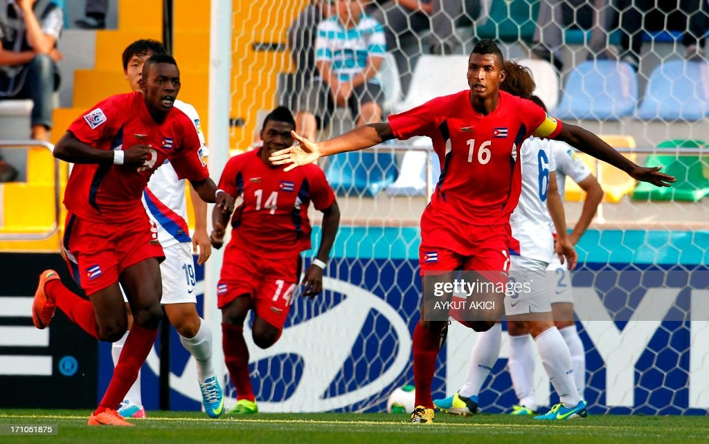 Cuba's Daniel Luis Saez (R) celebrate after scoring against South Korea during a group stage football match between Cuba and South Korea at the FIFA Under 20 World Cup at the Kadir Has stadium in Kayseri on June 21, 2013. AFP PHOTO/TURKPIX/Aykut AKICI