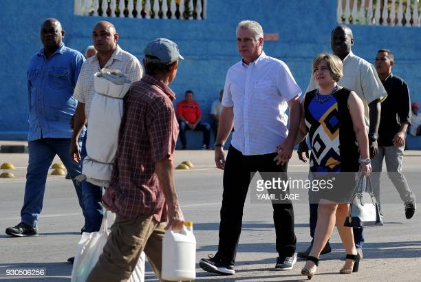 Cuba's First VicePresident Miguel DiazCanel and his wife Lis Cuesta arrive at a polling station in Santa Clara Cuba during an election to ratify a...