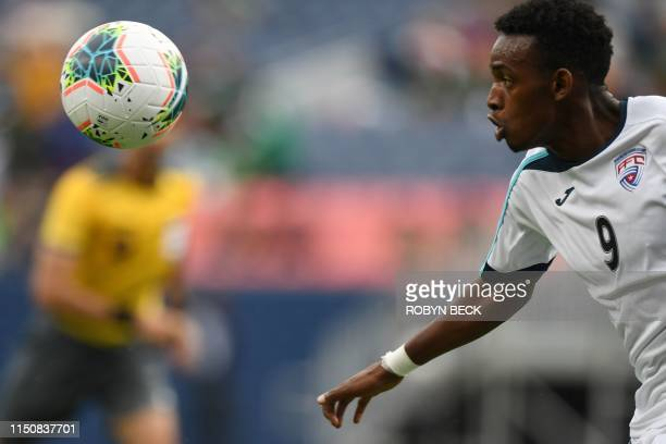 Cuba's forward Maykel Reyes eyes the ball during the CONCACAF Gold Cup Group A match between Cuba and Martinique on June 19, 2019 at Broncos Mile...