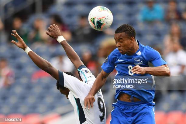 Cuba's forward Maykel Reyes jumps up with Martinique's defender Jordy Delem as he heads the ball during the CONCACAF Gold Cup Group A match between...