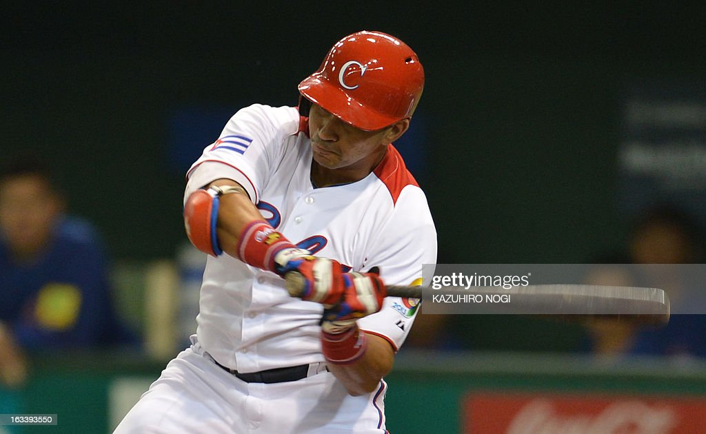Cuba's Frederich Cepeda makes a two-run homer against Taiwan during the first inning of their second-round Pool 1 game in the World Baseball Classic tournament at the Tokyo Dome on March 9, 2013.
