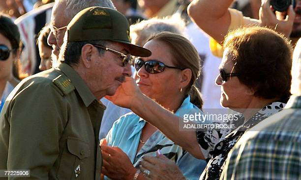 Cuba's interim president Raul Castro greets the widow of revolutionary leader Ernesto 'Che' Guevara Aleida March during the official ceremony to...