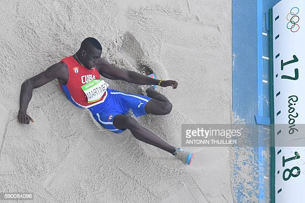 Cuba's Lazaro Martinez competes in the Men's Triple Jump Final during the athletics event at the Rio 2016 Olympic Games at the Olympic Stadium in Rio...