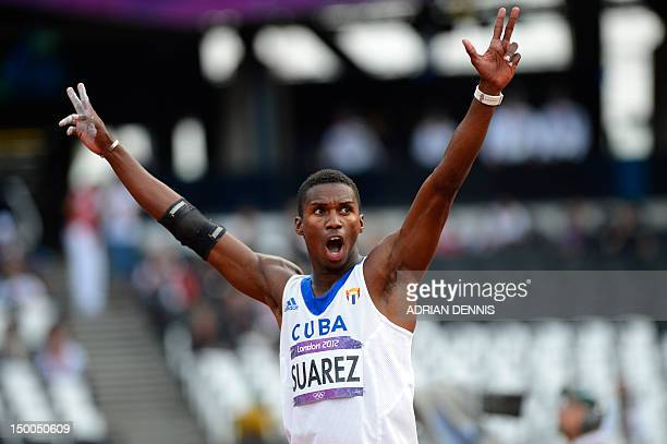 Cuba's Leonel Suarez reacts while competing in the men's decathlon javelin throw at the athletics event during the London 2012 Olympic Games on...