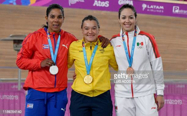 Cuba's Lisandra Guerra Colombia's Martha Bayona and Mexico's Yuli Paola Verdugo pose on the podium with their silver gold and bronze medals after...