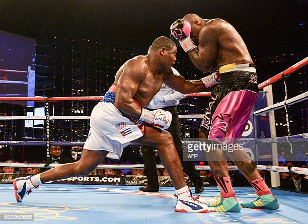Cuba's Luis Ortiz fights with US Malik Scott during the WBA Intercontinental heavyweight fight in Monte Carlo on November 12 2016 Ortiz defeated...