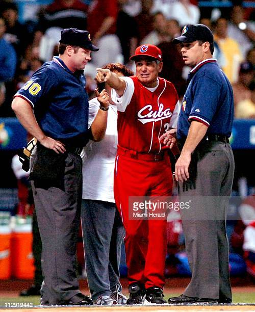 Cuba's manager Higinio Velez complains about a bat boy situation early in the game during the World Baseball Classic at Hiram Bitorn Stadium in San...