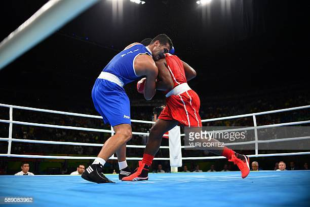 TOPSHOT Cuba's Pero Leinier Eunice fights Italy's Vianello Guido during the Men's Super Heavy at the Rio 2016 Olympic Games at the Riocentro Pavilion...