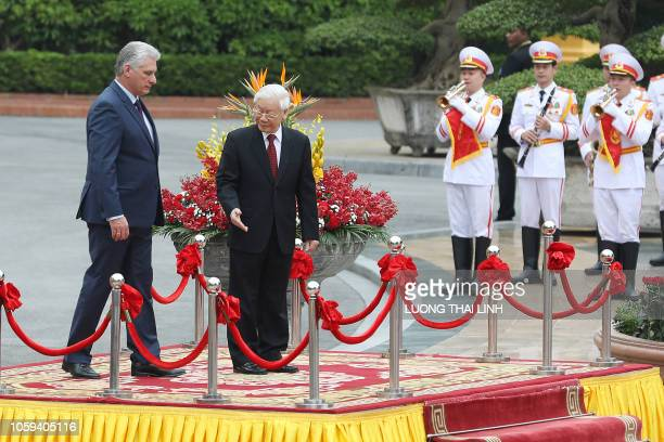 Cuba's President Miguel DiazCanel accompanied by his Vietnamese counterpart Nguyen Phu Trong as he reviews a guard of honor during a welcoming...