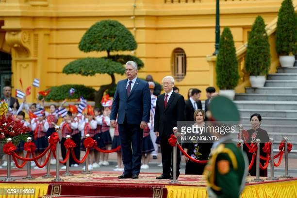 Cuba's President Miguel DiazCanel and his Vietnamese counterpart Nguyen Phu Trong review a guard of honor during a welcoming ceremony at the...