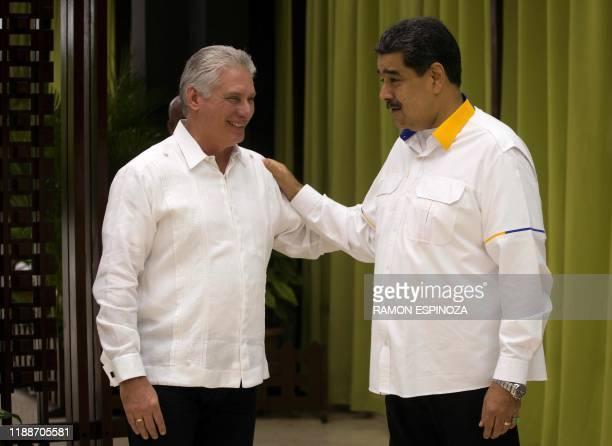 Cuba's President Miguel Diaz-Canel greets Venezuela's President Nicolas Maduro during the XVII ALBA-TCP Summit inauguration, in Havana on December...