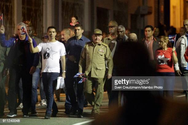 Cuba's President Raul Castro and First Vice President Miguel Diaz Canel wave with Cuban flags as leading a march as Cuba celebrates the 165...