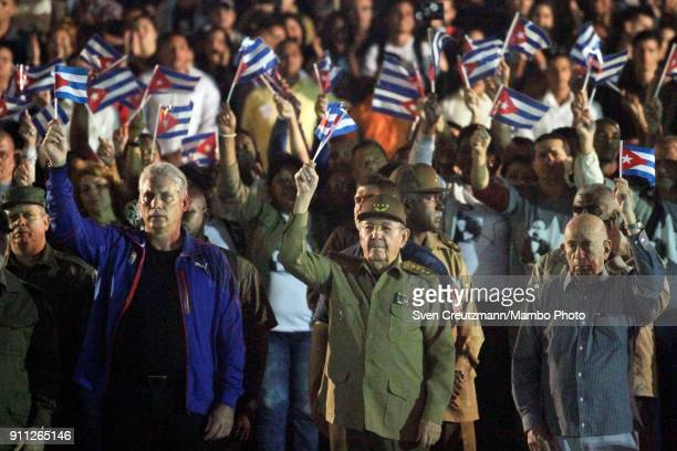 Cuba's President Raul Castro First Vice President Miguel Diaz Canel and Vice President Machado Ventura wave with Cuban prior to leading a march as...