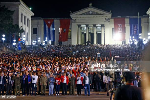 Cuba's President Raul Castro leads a march as Cuba celebrates the 165 anniversary of the birth of its national hero Jose Marti at the stairways of...