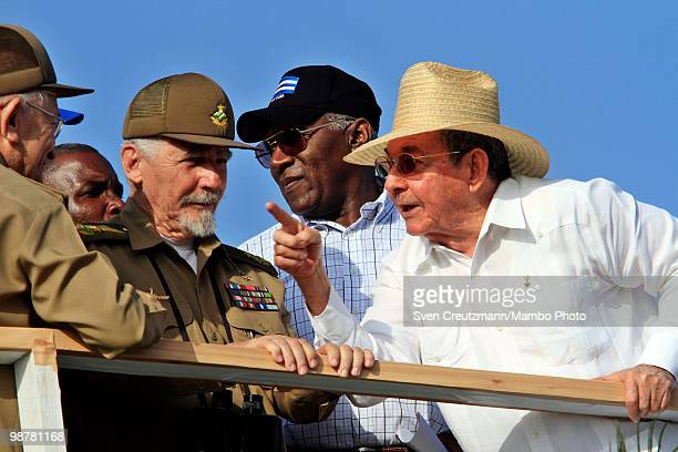 Cuba's President Raul Castro points as he talks with Guillermo Garcia Frias Ramiro Valdes and Salvador Valdes Mesa Secretary of Cuba's Workers Union...