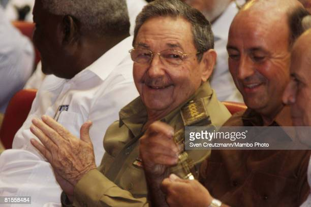 Cuba's President Raul Castro smiles as he talks with Cuba's Vice President Carlos Lage and Head of the National Assembly Ricardo Alarcon during a...