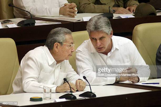 Cuba`s president Raul Castro talks to Miguel Diaz Canel First Vice President during the closing session of the National Assembly on December 20 in...